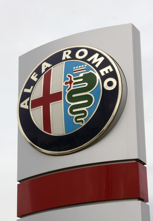 italian car: paris , France-september 15, 2015: Alfa Romeo Automobili is a renowned Italian car brand with a sporty image. this sign is located in paris