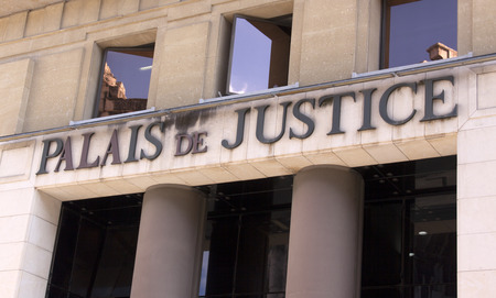 administered: nimes , France-september 14, 2015: palace of justice in Nimes france. Palace of Justice is a building where the bodies of a court are located and thus where justice is administered.