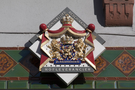 preference: Amsterdam, Netherlands-october 25, 2015: Sign on a wall of a Dutch purveyor of the king in Amsterdam