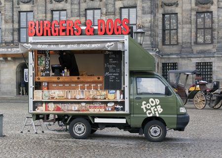 holland: Amsterdam, Netherlands-december 25, 2015:  Food truck on Dam square in Amsterdam Editorial