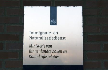 naturalization: Amsterdam, Netherlands-januari 8, 2016: sign of the Immigration and Naturalization Service of the Ministry of the Interior and Kingdom Relations