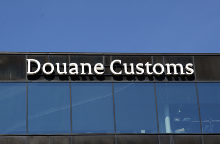 smuggling: Amsterdam, Netherlands-may 5, 2016: Letter douane customs on a building in amsterdam schiphol