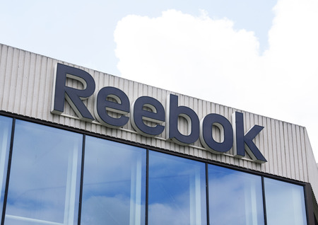 famous industries: Amsterdam, Netherlands-august 14, 2016: letters reebok on the headquarters in Amsterdam