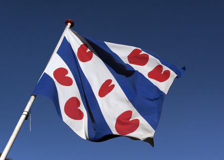 Amsterdam, Nederland-september 23, 2016: De vlag van de afdeling Friesland Holland