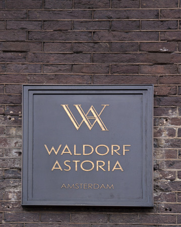 Flag of the waldorf astoria hotel in amsterdam: letters waldorf astoria on a facade in amsterdam Editoriali