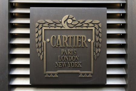 Amsterdam, Nederland-5 maart 2017: Word Cartier op een muur in amsterdam