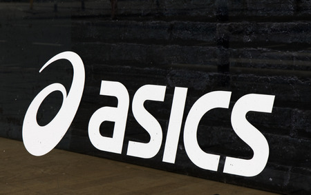 sixt letters in amsterdam: letters asics on a wall in amsterdam