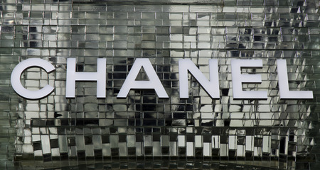 Amsterdam, Netherlands-march 5, 2017: letters chanel on a glass wall in amsterdam