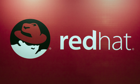 Amsterdam, Netherlands -september 15, 2017: redhat logo and letters on a red wall Editoriali