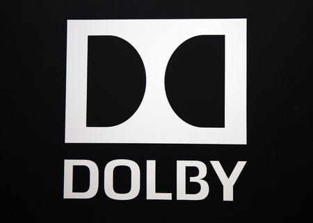 Amsterdam, Nederland 15 september 2017: Dolby logo en letters op een zwarte muur
