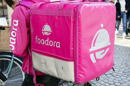 Amsterdam, Netherlands -december 17, 2017: Foodora courier with backpack in Amsterdam