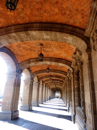 townhall: A passage under arches along Town Hall in Mexico City Stock Photo