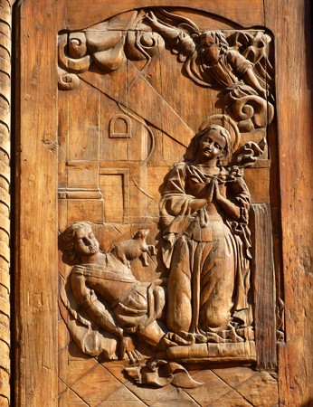 Annunciation : a bas-relief sculpture on a church door in Mexico City