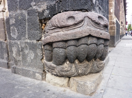 feathered: Pre-Columbian feathered snake fangs sculpture used as building block in Mexico City