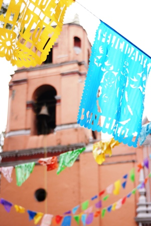 marcos: Flags for a saints day at a church in Mexico