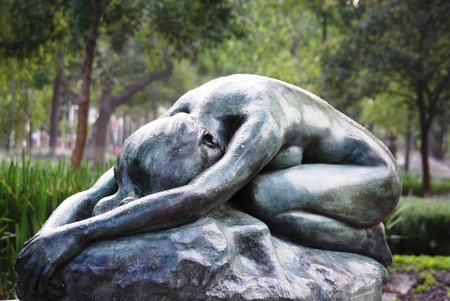 ocampo: A copy of the statue Desespoir in the Alameda Park in Mexico City in the rain