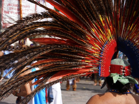 pre columbian: MEXICO CITY, MEXICO  December 12, 2015: Unknown Aztec dancers performing at the Our Lady of Guadalupe shrine celebrating Mexicos patron saints festival
