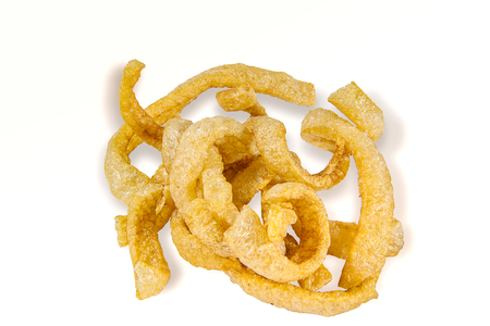 snack Thai food, fried pork crackling Its pork rind and fat isolated on white background, include with path filed.