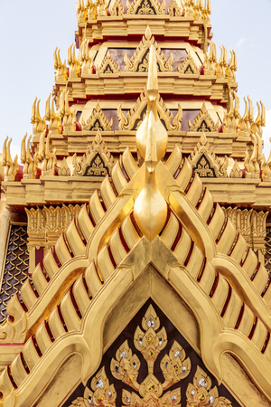 Close up on detail architecture of thai temple, abstract golden texture.
