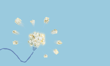 Thinking good idea pop up like a popcorn pop up with blue background, creative concept have a new idea. popcorn object include with path file. Stock Photo
