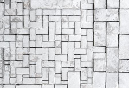 Parete bianca geometrica astratta del mosaico di struttura, modello di mosaico bianco sulla mappatura dell'oggetto 3D, fondo bianco pulito semplice per il pannello interno del pavimento o della parete del dettaglio. Archivio Fotografico - 88173596