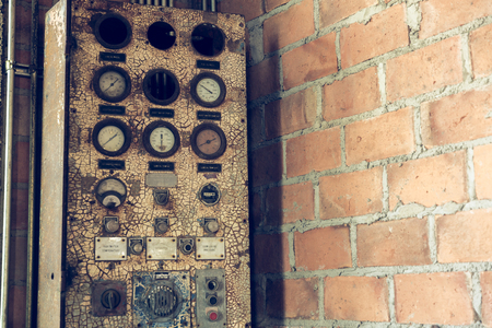 selective focus on the old PLC controller system electric with vintage filter. security background, electric cabinet.