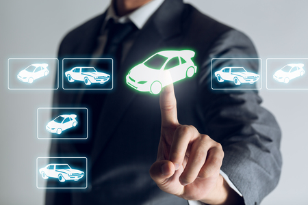 Businessman is shopping online to choose a cars to buy about internet of thing concept, Business background.