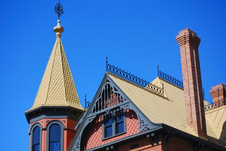 roof top of Victorian style house against a blue sky Stock Photo