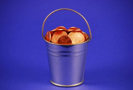 A metal bucket filled with shiny pennies