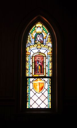 Religious stained glass window in a church.