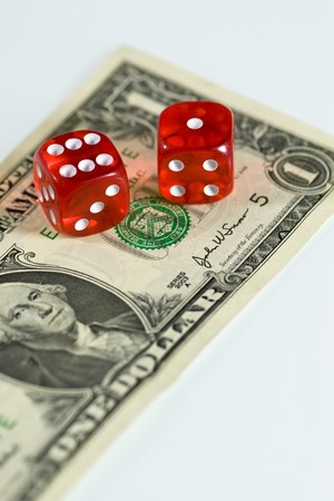 A pair of red dice on a 1 dollar bill