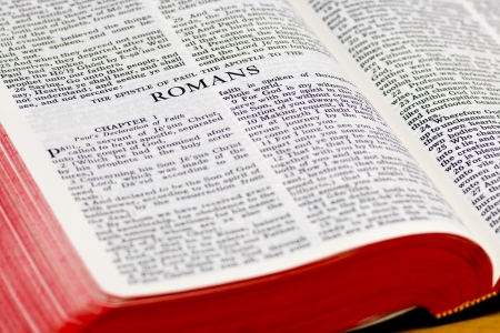 doctrine: Close up of Romans bible page Stock Photo