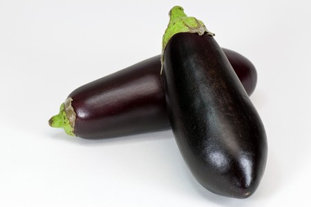 two eggplants on a white background