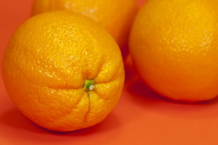 Fresh oranges on an orange background Stock Photo