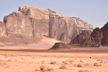 two lonely people wander through a vast desert valley 写真素材