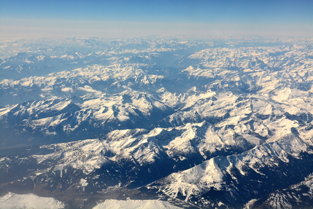 Snowy mountain ranges from the air Stock Photo - 94815896
