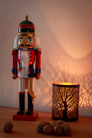 Nutcracker with candle as decoration for Advent and Christmas Stock Photo