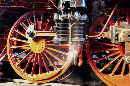 close-up of wheel and air pump of a steam engine of series 03 of the german Reichsbahn