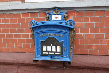 emptied: A blue mailbox Stock Photo