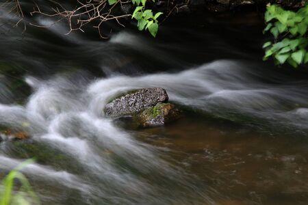 A stone in a small river