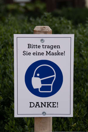 A mouth nose protection sign in a park Stock Photo