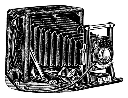 An antique engraved illustration of a camera with bellows, isolated on white  Created in 1909