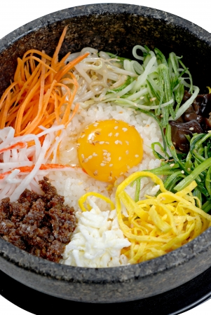 Korean rice with vegetable pork egg in hot bowl