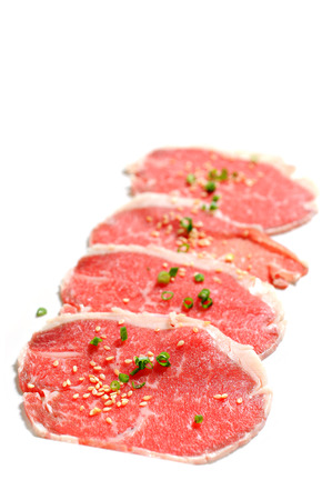 Beef slices isolated on white with sesame and Onion