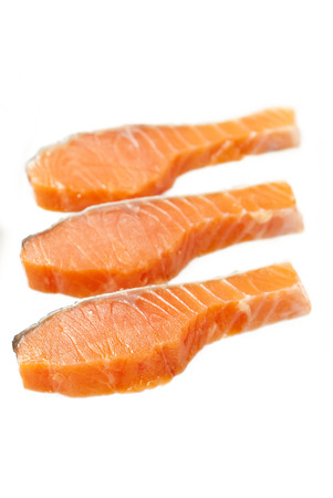 3 pieces of Raw Salmon Slices on white  Stock Photo