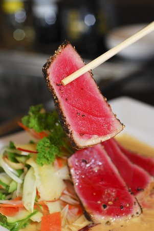 Seared Tuna with chopsticks Stock Photo