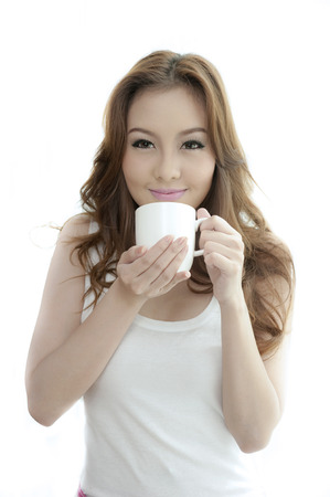 asian young woman drinking coffee on white background  photo