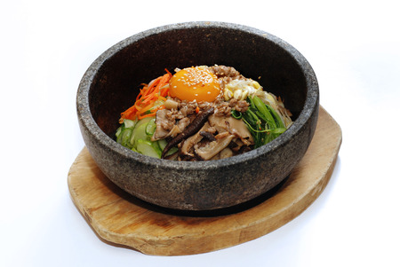 Korean rice with vegetable pork egg in hot bowl photo