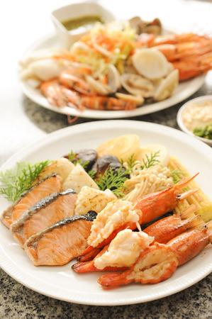 Shrimps, salmon slice, squid grilled, teppanyaki, japanese food photo