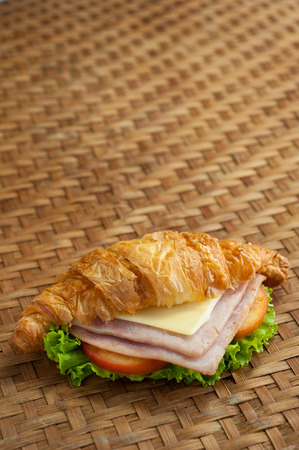 croissant ham cheese on brown bamboo weave Stock Photo